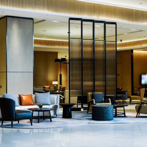 Hotel,Lobby,Interior,With,Reception,Desk,,Sofas,,Marble,Floor,And