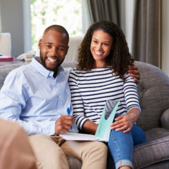 Happy,Young,Couple,Taking,Financial,Advice,At,Home